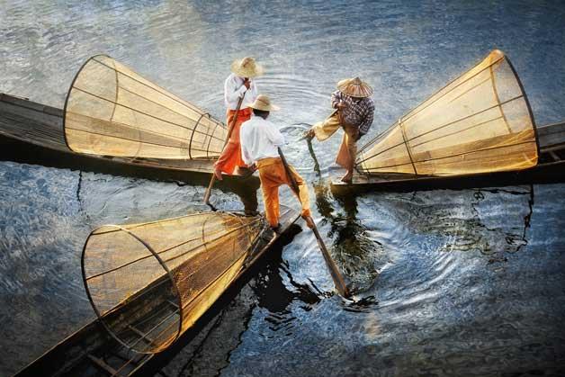 tres pescadores en el lago Inle