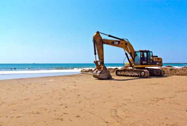 extracción de arena en una playa