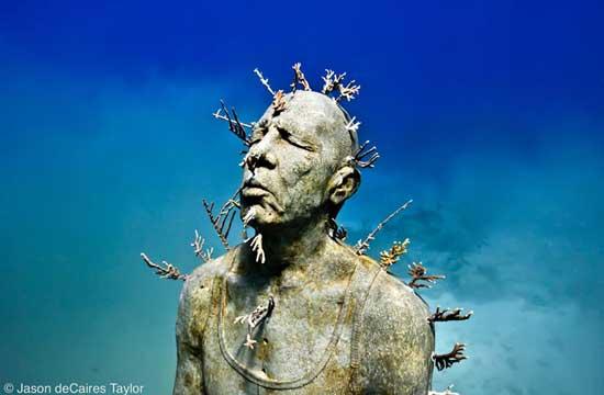 hombre de fuego, escultura Museo subacuático, Cancún - México