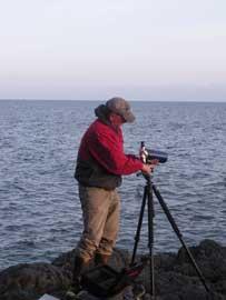 observación de nutrias con telescopio