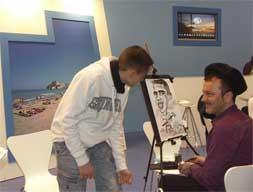 caricaturista stand de Peñíscola Fitur 2010